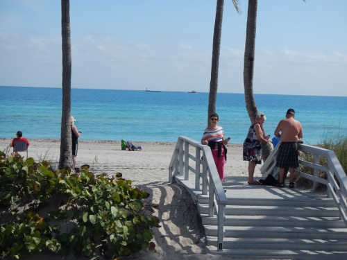 Kathy poses at one of the countless entrances         to the beaches of Fort Lauderdale