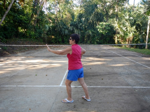Kathy does       Thai Chi in the Tennis Court