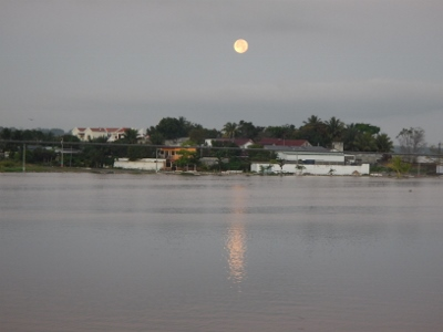 The full moon sets over         the town of Flores as viewed from our balcony