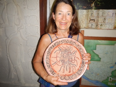 Kathy has a rare opportunity to hold a dish used           by the Mayans in the year 200BC