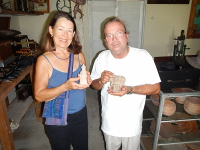 The museum owner Luis and Kathy hold whistle           artifacts used by the Mayan Culture