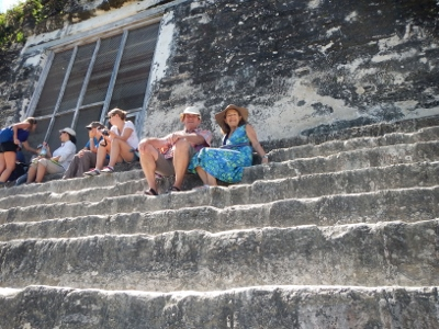 We relax         after a long climb to near the top on Temple Four the highest         Monument in Tikal