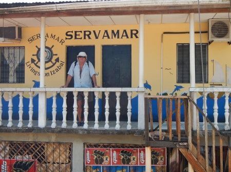 Brian poses in front of         Rauls office SERVAMAR in Livingston Guat